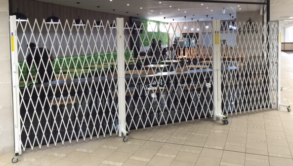 Expandable security doors for international airport contracts